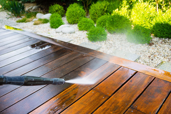 A deck being pressure washed